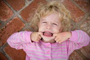 Young girl makes a face